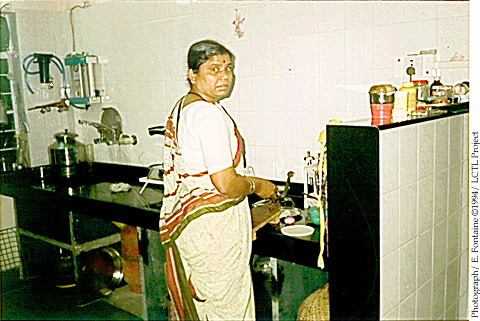 Kitchen Pictures on Woman At The Sink In Her Kitchen